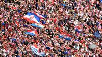 Les supporteurs croates réunis à Zagreb pour le retour de leur équipe, finaliste du Mondial, le 16 juillet 2018 à Zagreb [Denis Lovrovic / AFP]