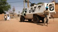 Un soldat de la Minusma devant un véhicule blindé, le 19 septembre à Tombouctou [SEBASTIEN RIEUSSEC / AFP/Archives]