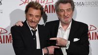 """Johnny Hallyday et Eddy Mitchell lors de la présentation du film de Claude lelouch """"Salaud, on t'aime"""", où ils ont tous deux joué, le 31 mars 2014 à Paris [Martin Bureau / AFP/Archives]"""