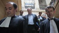 Alain Rosenberg (c), dirigeant de l'Eglise française de scientologie, au Palais de justice de Paris le 26 mai 2009 [Pierre Verdy / AFP/Archives]