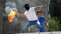 Un Palestinien lors de heurts avec les forces de sécurité israéliennes le 18 septembre 2015 à Hébron  [HAZEM BADER / AFP/Archives]