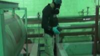 Capture d'une vidéo de la télévision syrienne montrant un inspecteur de l'OIAC en Syrie, le 8 octobre 2013 [ / Télévision syrienne/AFP/Archives]