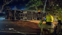 Le bus renversé après l'accident qui a causé la mort de 19 personnes à Hong Kong le 10 février 2018 [ISAAC LAWRENCE / AFP/Archives]