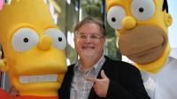 Le créateur des Simpsons, Matt Groening entouré des personnages de Bart et Homer sur le Hollywood Walk of Fame, le 14 février 2012 à Los Angeles [ROBYN BECK / AFP/Archives]