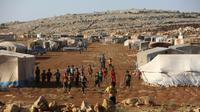 Des enfants se rassemblent dans un camp pour les déplacés à Kafr Dariyan, dans la province syrienne d'Idleb, le 26 août 2018  [OMAR HAJ KADOUR / AFP/Archives]