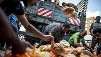 Distribution de rations de pain dans l'école primaire de Jabalia à Gaza pour les populations déplacées par le conflit avec Israël, le 29 juillet 2014  [Marco Longari / AFP/Archives]