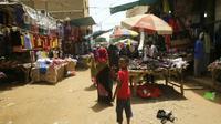 Des habitants au marché d'Omdurman, le 8 juin 2019 près de Khartoum, au Soudan [Ashraf SHAZLY / AFP]