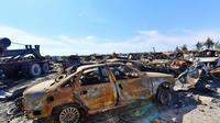 Des véhicules calcinés dans ce qui fut la dernière poche du groupe Etat islamique (EI) à Baghouz, dans l'est de la Syrie, le 23 mars 2019 [GIUSEPPE CACACE / AFP]