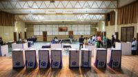 Un bureau de vote à Sophiatown, dans la banlieue de Johannesburg, juste avant la clôture du scrutin le 8 mai 2019 [WIKUS DE WET / AFP]