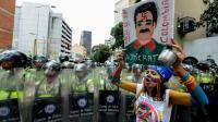 Des policiers bloquent des militants de l'opposition lors d'une marche à Caracas, le 16 septembre 2016 au Venezuela [FEDERICO PARRA / AFP/Archives]