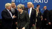 Le futur Premier ministre britannique Boris Johnson, la Première ministre sortante Theresa May et le président des Etats-Unis Donald Trump, ici lors d'une réunion de l'Otan à Bruxelles en mai 2017, alors que le premier était encore ministre des Affaires étrangères [Matt Dunham / POOL/AFP/Archives]