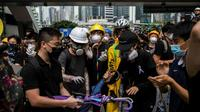 Protesters remained in control of key roads in Hong Kong on Monday morning [ISAAC LAWRENCE / AFP]