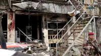 Capture d'écran d'une vidéo publiée par Hawar News Agency (ANHA) le 16 janvier 2019 montre un membre non identifié des forces de sécurité sur le lieu de l'attentat suicide contre une patrouille américaine de la coalition internationale antijihadistes dans la ville de Minbej dans le nord de la Syrie [- / AFP]