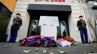 Cérémonie en hommage aux victimes des attentats du 13 novembre 2015, devant la Bataclan à Paris, le 13 novembre 2018 [BENOIT TESSIER / POOL/AFP/Archives]