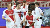 Le milieu espagnol de Monaco Cesc Fabregas (c) fêté par ses coéquipiers après son but contre Toulouse, le 2 février 2019 au stade Louis-II   [VALERY HACHE / AFP]