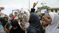 Des manifestants défilent à Srinagar, la capitale du Cachemire indien, pour protester contre la révocation de l'autonomie de la région par New Delhi, le 16 août 2019 [STR / AFP]