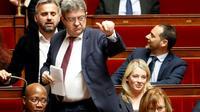 """Le chef de file de """"La France Insoumise"""" Jean-Luc Mélenchon (C)lors des questions au gouvernement, le 11 avril 2018 à l'Assemblée à Paris  [FRANCOIS GUILLOT / AFP/Archives]"""