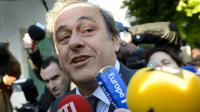 Michel Platini entouré par la presse à son arrivée au TAS à Lausanne, le 29 avril 2016 [FABRICE COFFRINI / AFP]