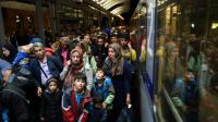 Des migrants arrivent à la gare de Saalfeld (est de l'Allemagne), le 5 septembre 2015  [HENDRIK SCHMIDT / DPA/AFP]