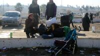 Des civils évacués d'Alep arrivent à Khan al-Assal, le 19 décembre.