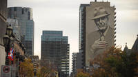 Deux immenses fresques murales à l'effigie de l'artiste ont été inaugurées lundi à Montréal.