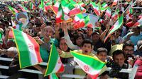 Des Iraniens assistent à un meeting du président Hassan Rohani à Sabzevar, dans le nord-ouest du pays, le 6 mai 2018 [- / Iranian Presidency/AFP]