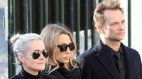 Laeticia Hallyday (à gauche), Laura Smet (au centre) et David Hallyday (à droite) lors des funérailles de Johnny Hallyday le 9 décembre 2017  [ludovic MARIN / AFP/Archives]
