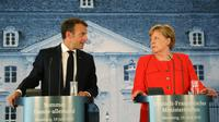 Emmanuel Macron au côté d'Angela Merkel le 19 juin 2018 [LUDOVIC MARIN / AFP]