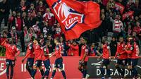L'attaquant de Lille Nicolas Pépé (g) buteur lors de la victoire 5-0 sur Nîmes à Villeneuve d'Ascq le 28 avril 2019 [PHILIPPE HUGUEN / AFP]