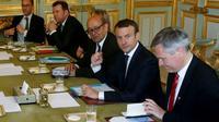Le président Emmanuel Macron accompagné de Jean-Yves Le Drian, à l'Elysée le 21 juin 2017 [GEOFFROY VAN DER HASSELT / POOL/AFP]