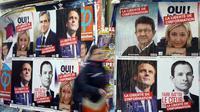Affiches électorales des candidats à l'élection présidentielle le 9 avril 2017 à Paris [Gabriel Bouys / AFP/Archives]