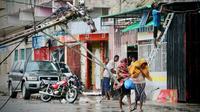 Une rue de Beira le 17 mars 2019, au lendemain du passage du cyclone Idai [ADRIEN BARBIER / AFP]
