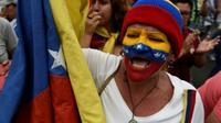 Une manifestante pro-Guaido lors d'un meeting à Los Teques, au  Venezuela, le 30 mars 2019 [Federico PARRA / AFP]