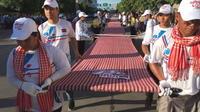 Record Guinness de l'écharpe tissée la plus longue