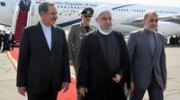 Photo fournie par la présidence iranienne montrant le président iranien Hassan Rohani (centre) à son arrivée à Téhéran, le 27 septembre 2019 [- / Iranian Presidency/AFP]