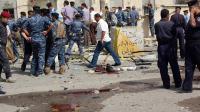 La police et l'armée irakiennes sur le site d'une attaque suicide contre un poste de police  ele 13 juin 2011 à Bassorah [- / AFP/Archives]