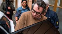 Jean-Claude Arnault quitte le tribunal au premier jour de son procès en appel à Stockholm, le 12 novembre 2018 [Jonathan NACKSTRAND / AFP]