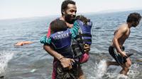 Arrivée de migrants en provenance de Turquie le 14 août 2015 sur l'île grecque de Lesbos [ACHILLEAS ZAVALLIS / AFP/Archives]