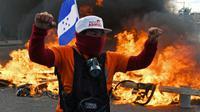 Un opposant hondurien proteste contre la réelection du président Juan Orlando Hernandez, le 27 janvier 2018 à Tegucigalpa [ORLANDO SIERRA / AFP]