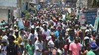 Manifestation contre le gouvernement du président haïtien Jovenel Moise, le 14 juillet 2018 à Port-au-Prince [HECTOR RETAMAL / AFP]