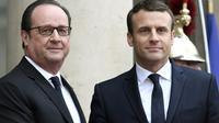 François Hollande (g) et son successeur à l'Elysée Emmanuel Macron, le 14 mai 2017 à Paris [STEPHANE DE SAKUTIN / AFP/Archives]
