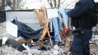 Un policier devant un campement de roms évacué le 27 novembre 2013 à Saint-Ouen  [Kenzo Tribouillard / AFP/Archives]
