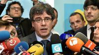 L'indépendantiste catalan Carles Puigdemont (c), le 24 janvier 2018 à Bruxelles [JOHN THYS / AFP]