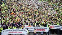 Des frontaliers manifestent près de la frontière franco-suisse à Saint Louis, le 1er février 2014 pour avoir le droit de choisir leur système de santé [Sebastien Bozon / AFP/Archives]