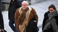 Alain Jakubowicz, l'avocat de Nordahl Lelandais, arrive au Palais de justice de Grenoble où son client va être présenté de nouveau aux juges d'instruction, le 19 mars 2018 [JEAN-PIERRE CLATOT / AFP]
