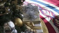 A peine déballés, des cadeaux de Noël trouvent une deuxième vie sur Internet. [mari matsuri / AFP]