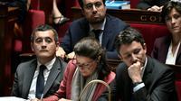 Agnès Buzyn (c) et Gérald Darmanin (g) à l'Assemblée nationale, le 16 octobre 2018 [STEPHANE DE SAKUTIN / AFP/Archives]