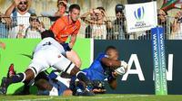 Le Français Cameron Woki inscrit un essai contre l'Angleterre en finale du Mondial U20, le 17 juin 2018 à Béziers [SYLVAIN THOMAS / AFP]