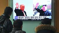 Une chaîne de télévision sud-coréenne rapporte l'annonce historique d'un sommet en tre Donald Trump et Kim Jong Un [Jung Yeon-je / AFP]