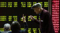 Le tableau des changes le 7 janvier 2016 à Pékin [FRED DUFOUR / AFP]